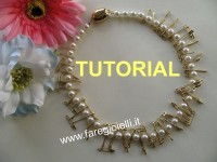 collana-di-perle-con spilla balia